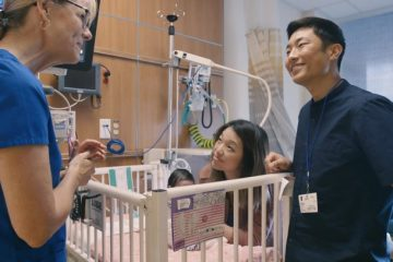 Parents in the NICU with their child and nurse