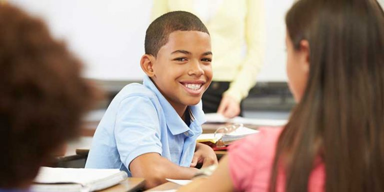 Preteen boy and girl in a classroom