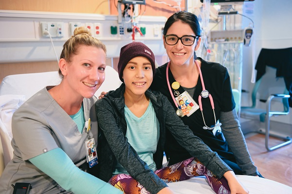 oncology patient smiling with her nurses