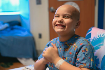 smiling oncology patient in hospital room
