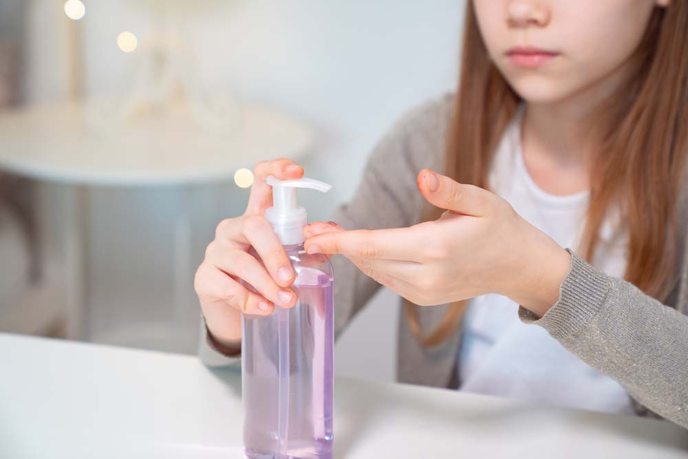 Teenage girl washes hands