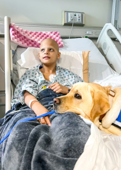 CHOC resident dog Lois supports a patient
